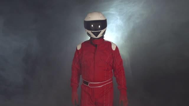 Motor racing / Formula One Driver walking through smoke with Helmet video