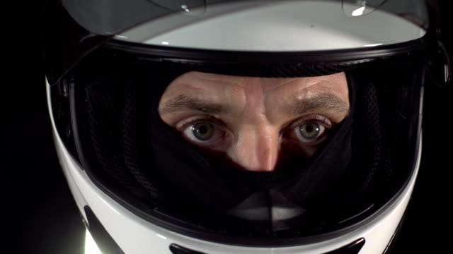 Motor racing / Formula One Motorbike Driver visor close up video