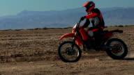 Motorbike coming towards in desert video