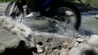 motorbike crossing creek water splashing video