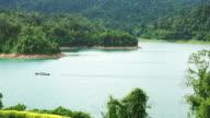 Motorboat in lake at Ratchaprapa Dam video
