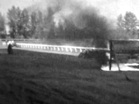 Motorcycle crashes through fire--1930's film video