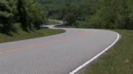 motorcycle drives winding road video