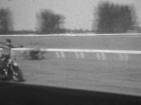 Motorcycle duo stunt ride--From 1930's film video