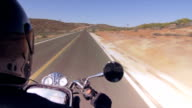 Motorcycle rider in a lonely desert road video