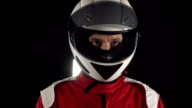 Motorcyclist / Formula One Driver looking up - Slow motion video