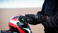 Motorcyclist removes his gloves video