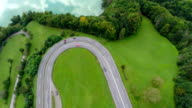 Motorway road turn with traffic near the lake video