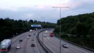 Motorway traffic at sunset time-lapse video