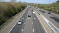 UK motorway traffic with cars lorries and vehicles travelling on major roadway M5 video