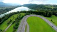 Motorway turn with traffic near a big lake video