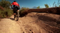 Mountain bike riding on dirt road showing it's tire tread video