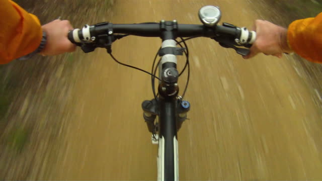 Mountain Bike travelling fast along track video