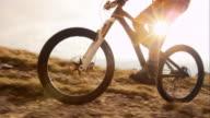 TS SLO MO mountain biker ascending to the top video