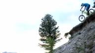 Mountain biker descends steep mountain slope of dirt, rocks video