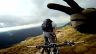 POV mountain biker looking at friend and doing thumbs up video