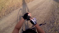 Mountain biker looking for route on smartphone video