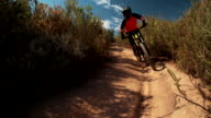 Mountain biker on a cross country back road trail video