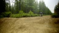 Mountain biker on rough dirt road trail video