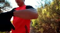 Mountain biker putting on gloves video