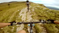 POV mountain biker riding behind his friend video