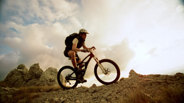 SLO MO mountain biker riding down the ridge video
