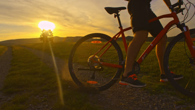 SLO MO Mountain biker riding his bike at sunset video