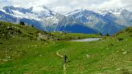 Mountain Biker Riding In Alpine Landscape (4K/UHD to HD) video