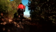 Mountain biker riding on a cross country dirt road video