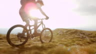 TS SLO MO mountain biker riding on top of plateau video