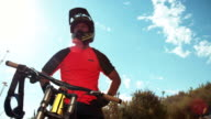 Mountain biker taking a break on cross country off-road trail video