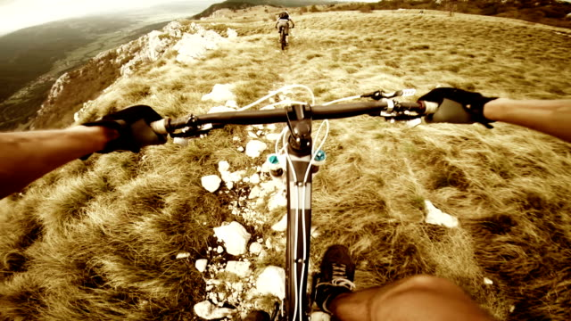 POV Mountain bikers gives thumb up and rides the ridge video