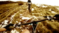 POV Mountain bikers going uphill video