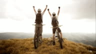 TS SLO MO Mountain bikers reaching the top video