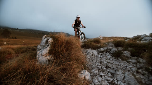 SLO MO mountain bikers riding over rocks video