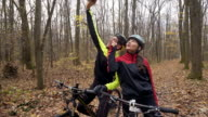 Mountain bikers taking a selfie in the forest. video