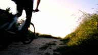 Mountain biking cyclist person cycling on biking trail path video