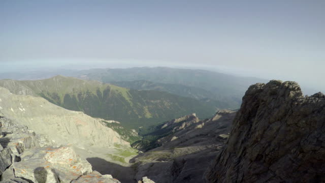 Mountain climber pov from helmet camera on top to dangerous Olympus summit Mytikas in Greece video