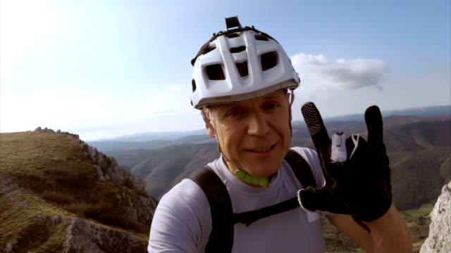 Mountain cyclist showing the landscape while on video call video