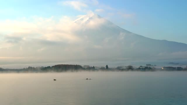 Mountain Fuji and Kawaguchiko lake with morning mist in autumn season video