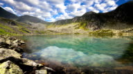 Mountain lake with reflection on the smooth water. video