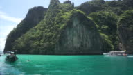Mountain of tropical islands of Phuket, Krabi in Thailand. Boat trip in the middle of crystal green ocean lagoon video