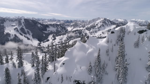 Mountain Peak Aerial Reveal of Stevens Pass Winter Ski Resort in 60P 4K video