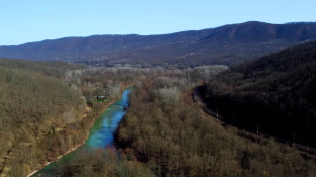 mountain river in early spring, aerial view video