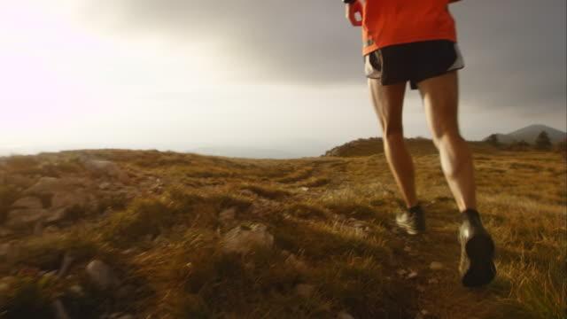TS SLO MO mountain runner at sunset video