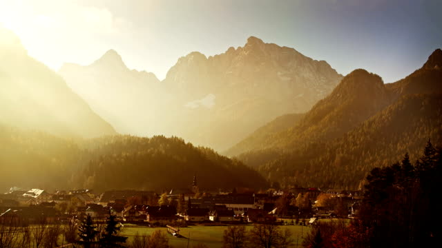 Mountain valley village bathing in the golden morning light video