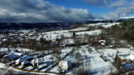 Mountain village in winter, aerial view video