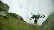 Mountainbiker carrying his bike up a hill video