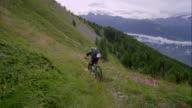 Mountainbiker driving down a hill video