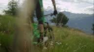 Mountainbiker driving in alpine terrain video